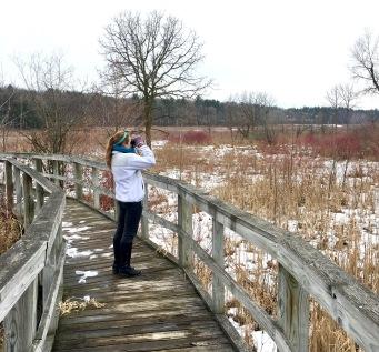 Olivia birding at the UW–Madison Arboretum